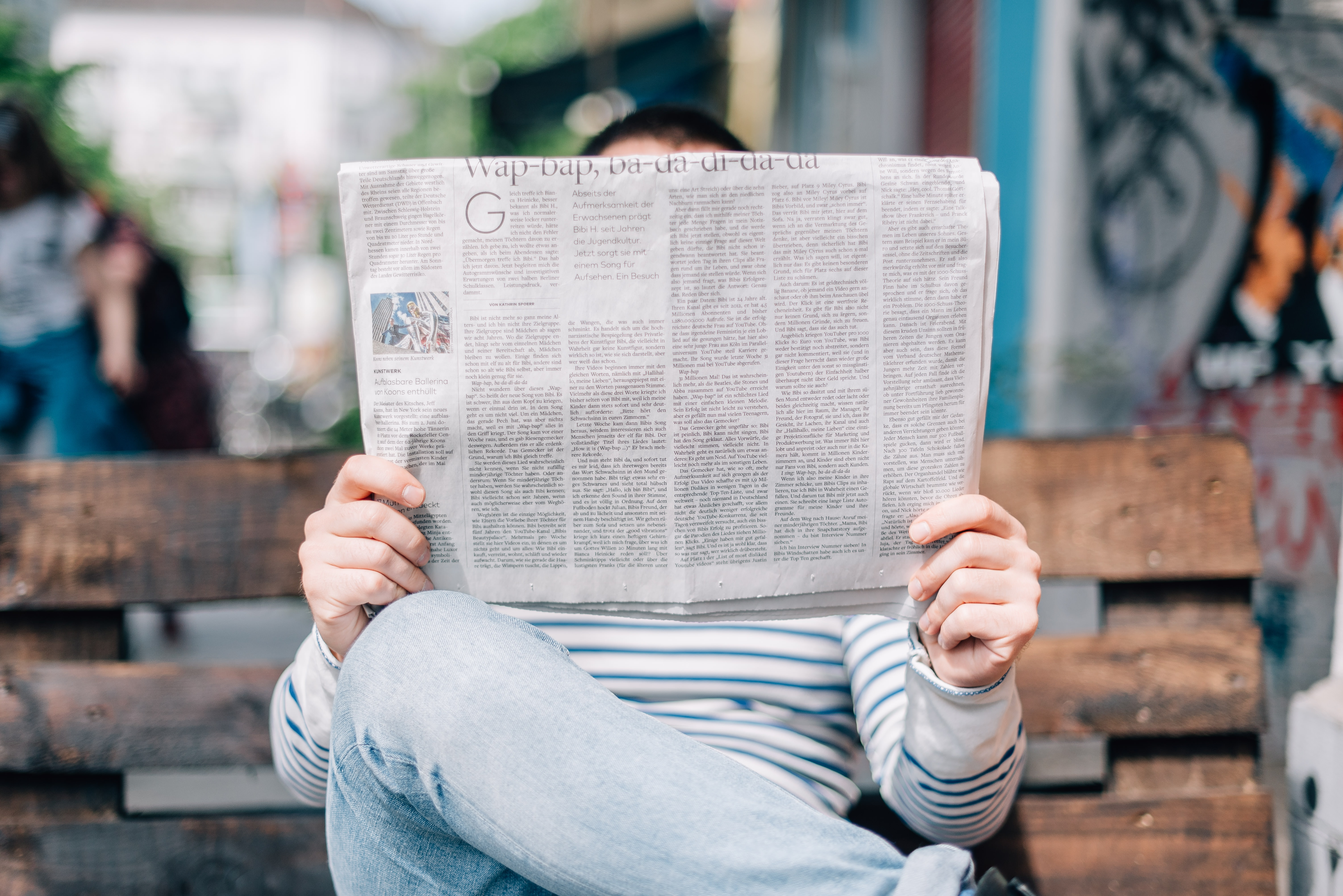 Picture of a man reading the news